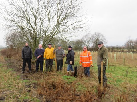 170212 Fencing volunteers braving the wet weather